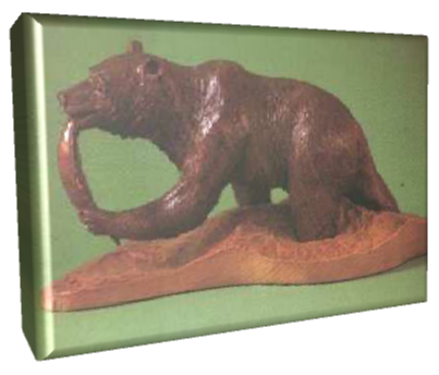 The Salmon Poacher carving by Ian Nicol